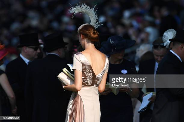 A spectator reads the racecard on Day Two of Royal Ascot at Ascot Racecourse on June 21 2017 in Ascot England