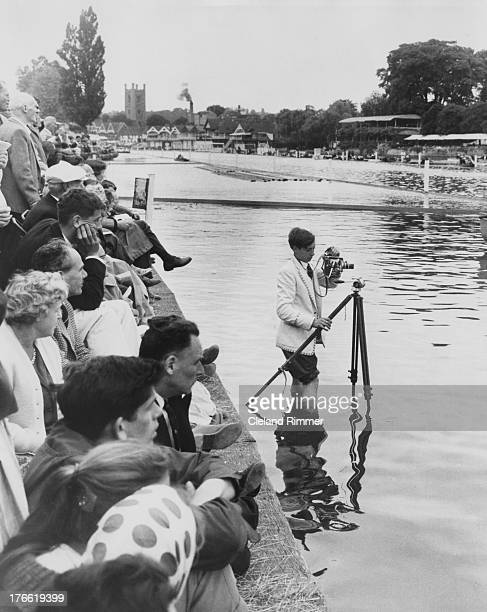 Spectator sets up a tripod in the water to film the Henley Royal Regatta on the Thames in Oxfordshire, 11th July 1962.