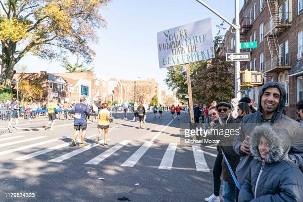 A spectator shows a sign stating that the runners are better than the government during 2019 TCS New York City Marathon in New York City on November...