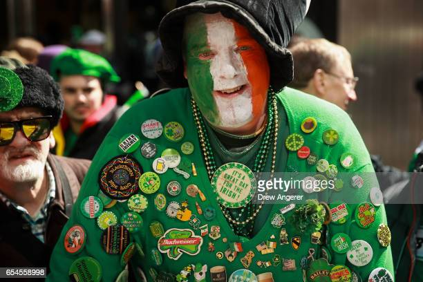 A spectator shows his Irish pride as he watches the annual St Patrick's Day parade March 17 2017 in New York City The New York City St Patrick's Day...