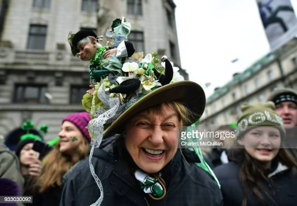A spectator shows off her hat as the annual Saint Patrick's day parade takes place on March 17 2018 in Dublin Ireland Dublin hosts the largest Saint...