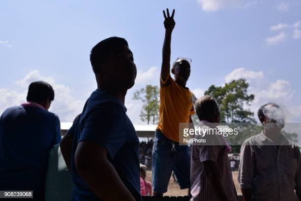A spectator signals a bet to a bookie during a bullfight arena in Nakhon Si Thammarat Province Thailand on January 20 2018 Bullfighting is a popular...