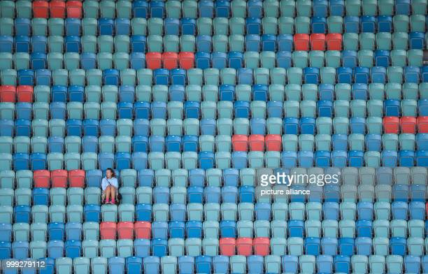 Spectator sits in the empty stands during the dressage Grand Prix in the Ullevi Stadion at the European Equestrian Championships in Gothenburg,...