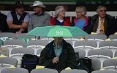 london england spectator sits rain before