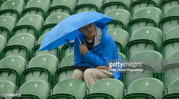 A spectator sits in the rain before the third day of the County Championship Division One match between Somerset and Essex on September 25 2019 in...