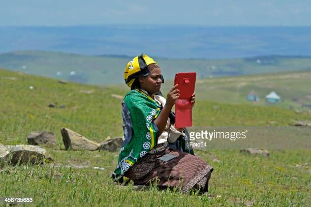 A spectator sits on a hill watching Madiba's State Funeral from afar on December 15 2013 in Qunu South Africa Nelson Mandela passed away on the...
