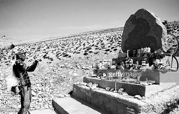 A spectator takes a photo of the Tommy Simpson memorial during stage fifteen of the 2013 Tour de France a 2425KM road stage from Givors to Mont...
