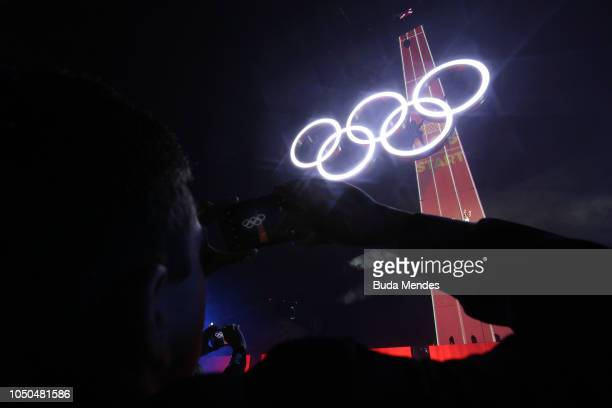 Spectator takes a picture during the opening ceremony of the Buenos Aires 2018 Youth Olympic Games at Obelisco monument on October 06 2018 in Buenos...