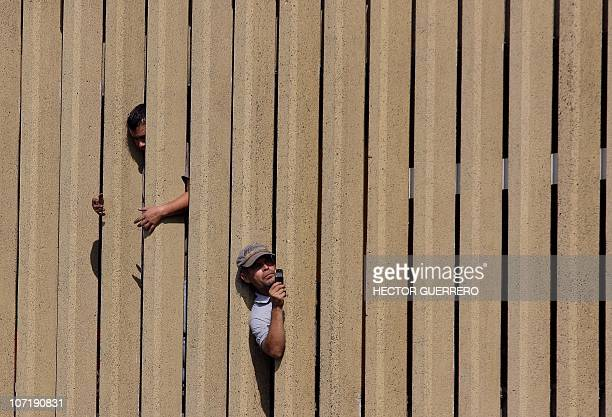 A spectator takes a picture of a giant marionette called 'Little Giant' of the French street theater company Royal de Luxe as it performs in...