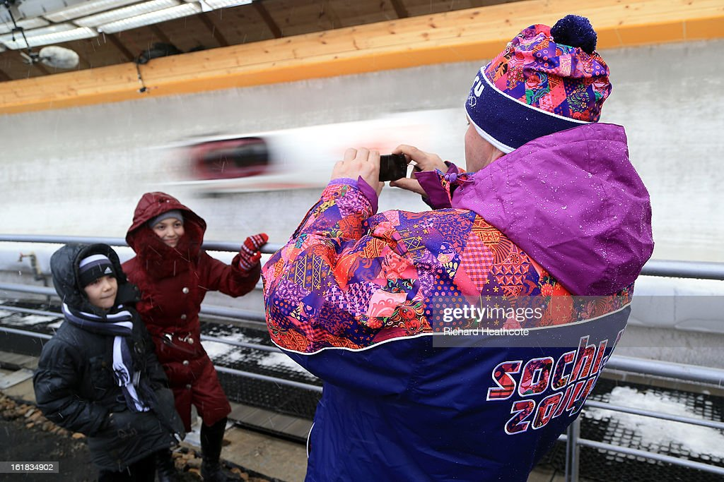 A spectator takes a picture of his children during the 4 man Bobsleigh Viessman FIBT Bob & Skeleton World Cup at the Sanki Sliding Center in Krasnya Polyana on February 17, 2013 in Sochi, Russia. Sochi is preparing for the 2014 Winter Olympics with test events across the venues.