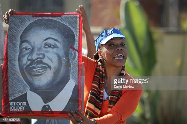 Spectator Tommie Johnson holds a picture of Dr Martin Luther King Jr at the 29th annual Kingdom Day Parade on January 20 2014 in Los Angeles...