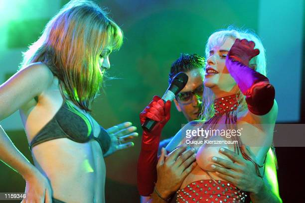 A spectator touches former porn star and former member of the Italian parliament Chicholina as she performs at the Love City Sexy Festival July...