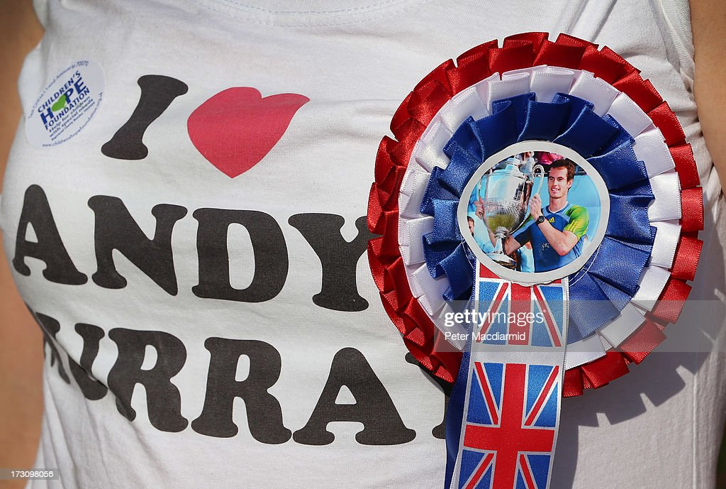 A spectator waits in line for tickets wearing a rosette in support of Andy Murray of Great Britain on men's finals day at the Wimbledon Lawn Tennis Championships at the All England Lawn Tennis and Croquet Club at Wimbledon on July 7, 2013 in London, England. Great Britain's Andy Murray will play Novak Djokovic of Serbia in today's gentleman's singles final on Centre Court.