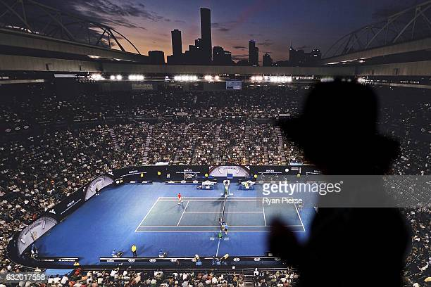 A spectator walks past a picture of Rod Laver Arena on day four of the 2017 Australian Open at Melbourne Park on January 19 2017 in Melbourne...