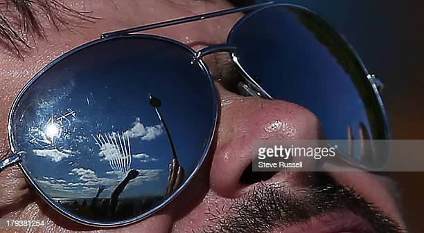 TORONTO ON SEPTEMBER 2 A spectator watches as the Canadian Forces Snowbirds leave nine smoke trails as they finish their performance during at the...