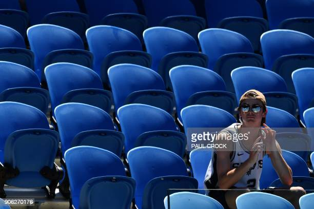 A spectator watches Denis Kudla of the US play against Austria's Dominic Thiem during their men's singles second round match on day four of the...