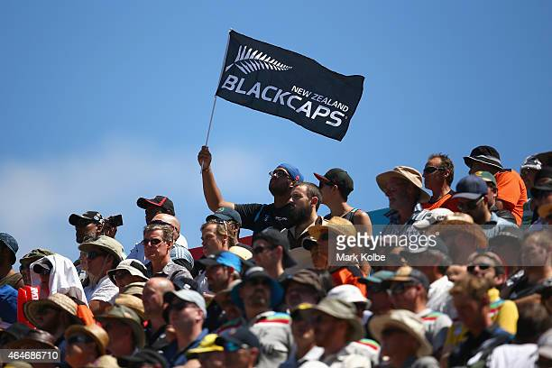 A spectator waves a Blackcaps flag during the national anthem before the 2015 ICC Cricket World Cup match between Australia and New Zealand at Eden...