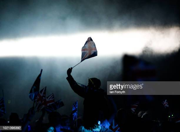 A spectator waves a Union Flag during Yorkshire's biggest openair proms of the summer at Castle Howard on August 18 2018 in Malton England Held in...