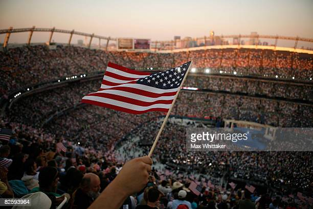Spectator waves American flags on day four of the Democratic National Convention at Invesco Field at Mile High August 28, 2008 in Denver, Colorado....
