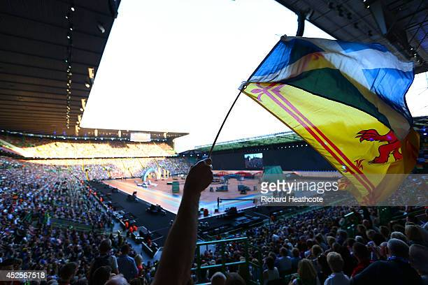 A spectator waves the Scottish national flag during the Opening Ceremony for the Glasgow 2014 Commonwealth Games at Celtic Park on July 23 2014 in...