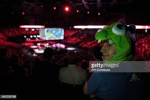A spectator wearing a hat watches the final of the 'LCS' the first European division of the video game 'League of Legends' between Misfits Gaming and...