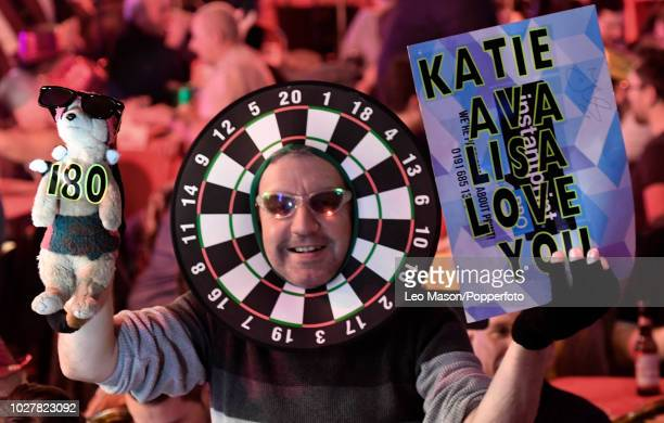 A spectator wearing fancy dress during a men's first round match on Day Two of the BDO Lakeside World Darts Championships at Lakeside Country Club...