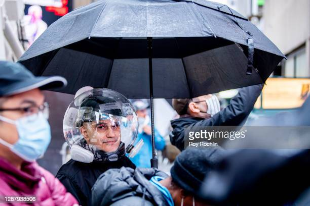 """Spectator wears a bubble or """"Covidisor"""" in place of a mask during 94th Annual Macy's Thanksgiving Day Parade on November 26, 2020 in New York City...."""