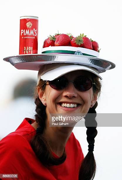 A spectator wears a hat sporting strawberries and Pimms on Day Four of the Wimbledon Lawn Tennis Championships at the All England Lawn Tennis and...