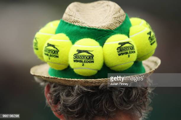A spectator wears a tennis ball hat on day eight of the Wimbledon Lawn Tennis Championships at All England Lawn Tennis and Croquet Club on July 10...