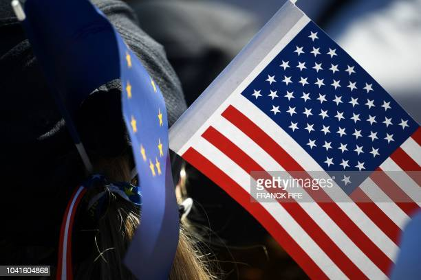 A spectator wears US and European flags during a practice session ahead of the 42nd Ryder Cup at Le Golf National Course at SaintQuentinenYvelines...