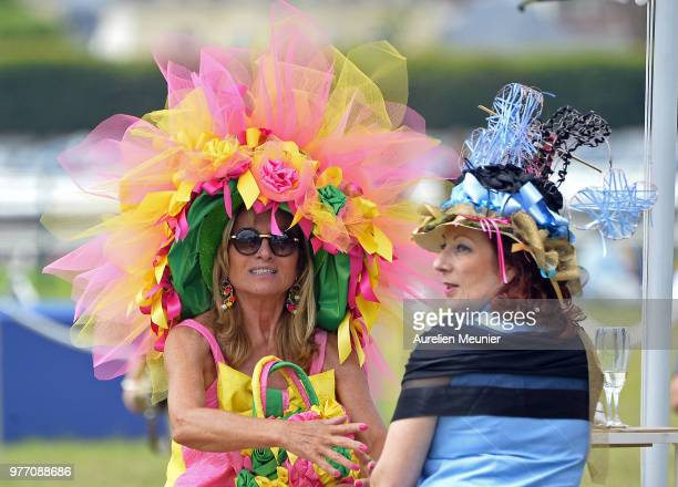 A spectator with a flower hat during the Prix de Diane Longines 2018 on June 17 2018 in Chantilly France