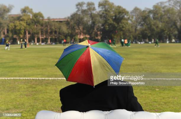 Spectator with an umbrella style hat at Aitchison College during the one-day match between Pakistan Shaheens the MCC on February 16, 2020 in Lahore,...