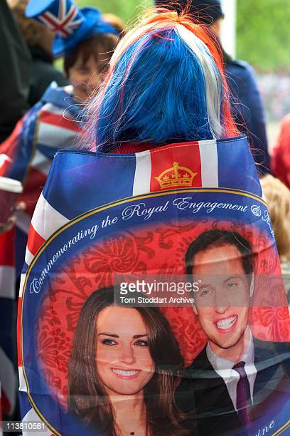 A spectator with red white and blue hair celebrates the wedding of Prince William and Kate Middleton Pall Mall London 29th April 2011