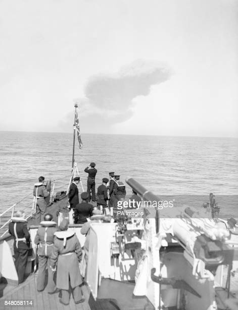 Spectators aboard HM Fleet minesweeper 'Albacore' watch the great pall of smoke rise into the air from a distance of 9 miles as Heligoland Germany's...