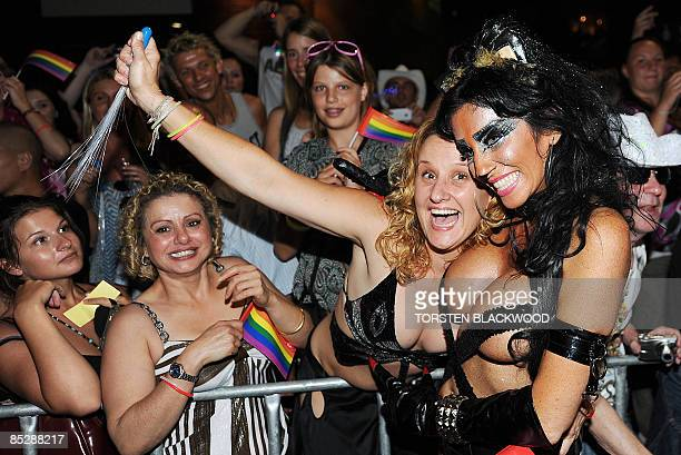 Spectators admire a dominatrix during the 31st annual Gay and Lesbian Mardi Gras parade through Sydney on March 7 2009 Over 9700 dancers and 134...