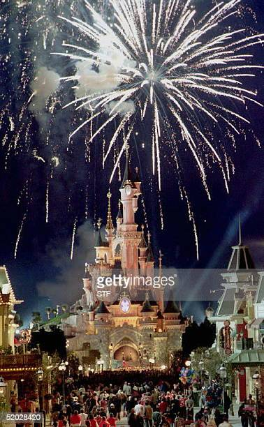 Spectators admire fireworks over Sleeping Beauty's castle late 11 April during the press preview of the new Euro Disney park. AFP PHOTO