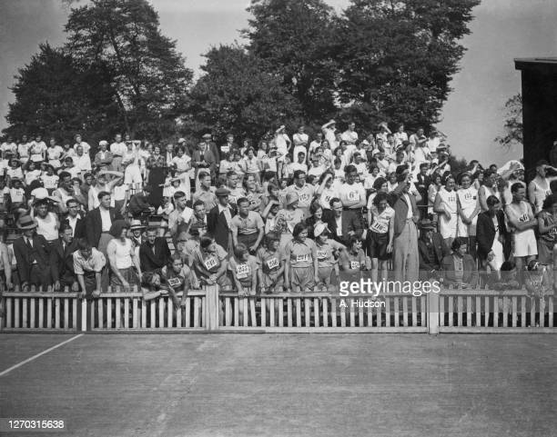 Spectators and competitors watching a laundry sports event at the Herne Hill track London 2nd September 1933