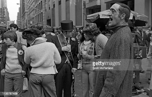 Spectators and participants gather together and talk along 5th Avenue prior to the start of the St Patrick's Day parade New York New York March 17...