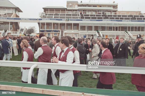 Spectators and staff being evacuated from the course after an IRA bomb threat at the 1997 Grand National Aintree near Liverpool 5th April 1997