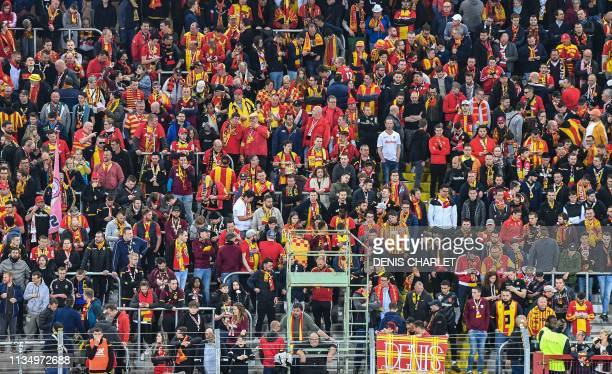 Spectators and supporters of Racing Club Lens watch a match from the Marek standing tribune of the Felix Bollaert stadium in Lens northern France on...