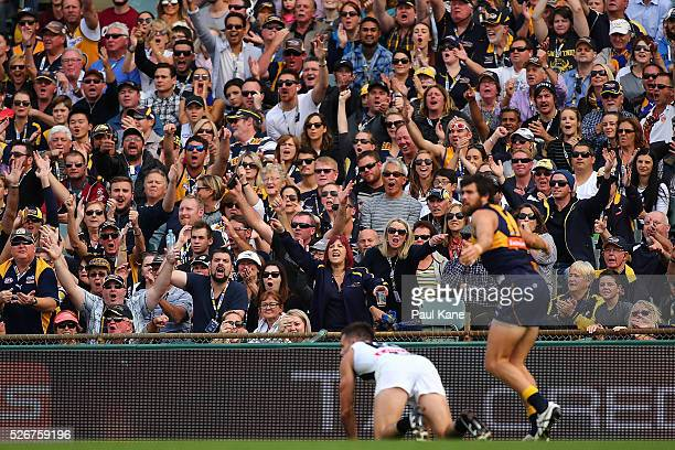 Spectators appeal for a free kick during the round six AFL match between the West Coast Eagles and the Collingwood Magpies at Domain Stadium on May 1...