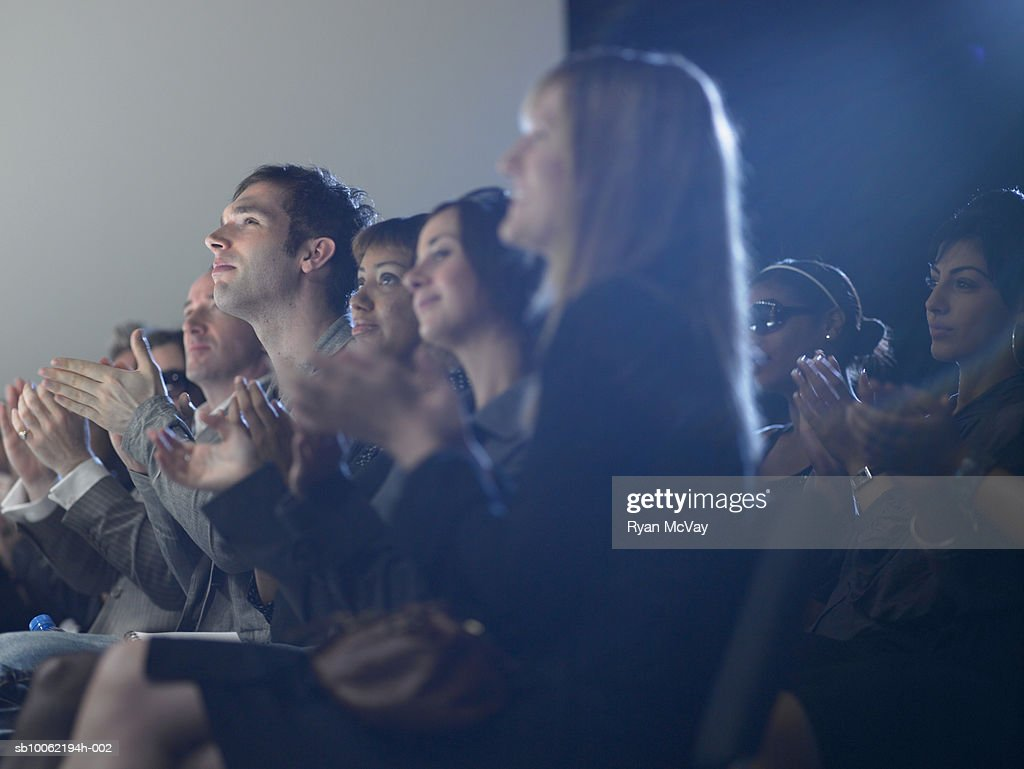 Spectators applauding at fashion show : Stock Photo