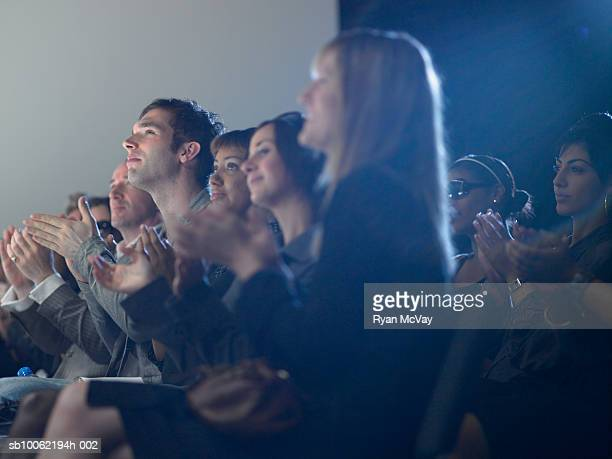 Spectators applauding at fashion show