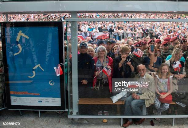 Spectators are seen as US President Donald Trump gives a speech in front of the Warsaw Uprising Monument on Krasinski Square during the Three Seas...