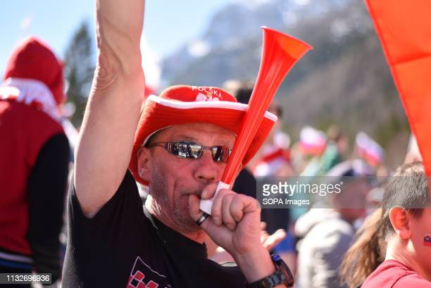 Spectators are seen cheering during the FIS Ski Jumping World Cup Flying Hill Individual Finals in Planica
