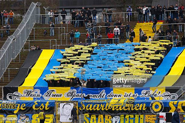 Spectators are seen during the Regionalliga match between 1 FC Saarbruecken and Wormatia Worms at the Ludwigspark stadium on December 5 2009 in...