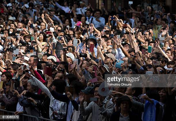 Spectators are seen during the Rio Olympics 2016 Japanese medalist parade in the ginza district on October 7 2016 in Tokyo Japan