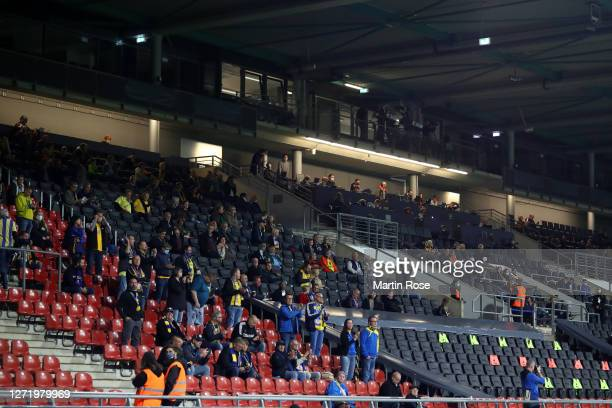 Spectators are seen in the stands prior to the DFB Cup first round match between Eintracht Braunschweig and Hertha BSC at EintrachtStadion on...