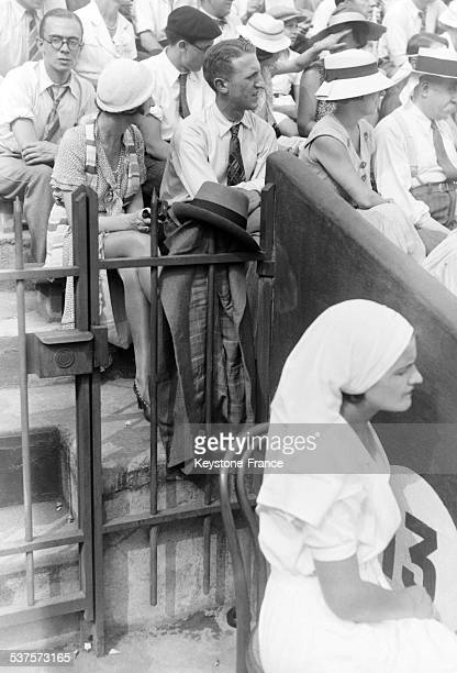 Spectators are watching matches of the Davis Cup at Roland Garros in 1933 in Paris France