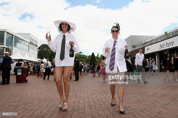 Spectators arrive at the 2009 Melbourne Cup Day meeting at Flemington Racecourse on November 3 2009 in Melbourne Australia